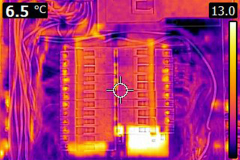 Home Inspector Oakville a thermal image picture of an electrical panel showing the types of defects a home inspector can detect with a  thermal imager that you can not see with the naked eye